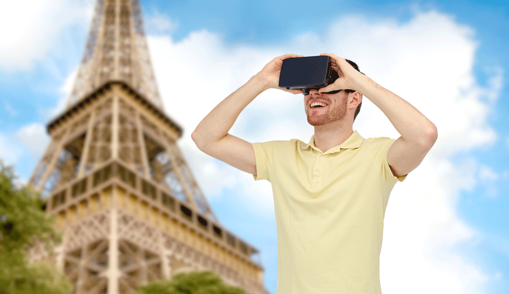 picture of man holding virtual reality device with Eiffel tower in background