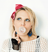 image of girl blowing a bubble with gum