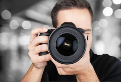Image of Man using camera