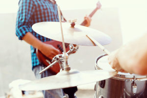image of a man playing guitar in band