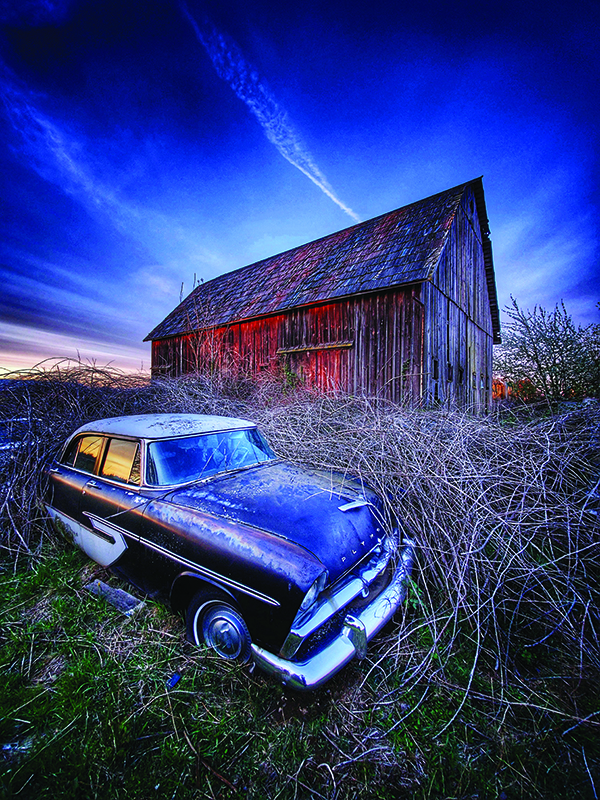 image of car and barn