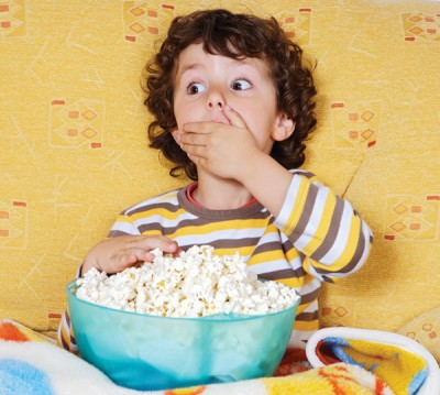 Image of boy eating popcorn