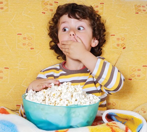 Image of boy eating popcorn