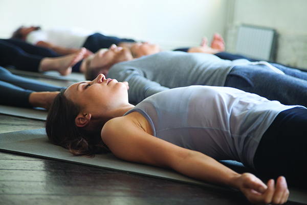 Image of adults practicing yoga