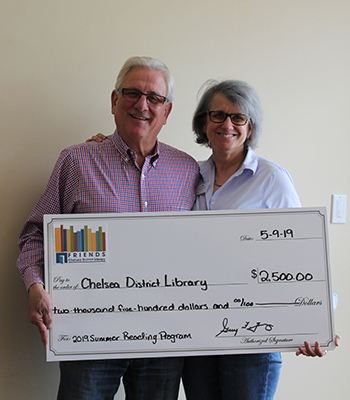 Image of Lori and Gary Z with large sponsor check