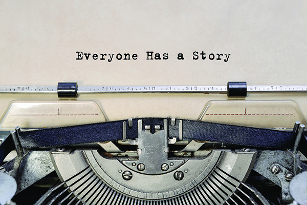 image of typewriter with text everyone has a story on the paper