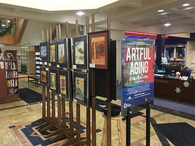 Image of paintings on easels in library