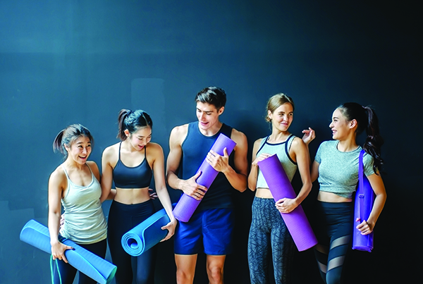 image of teens with yoga mats