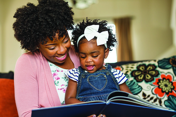 image of mother reading to toddler