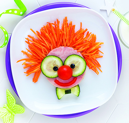 image of a clown face made out of food items